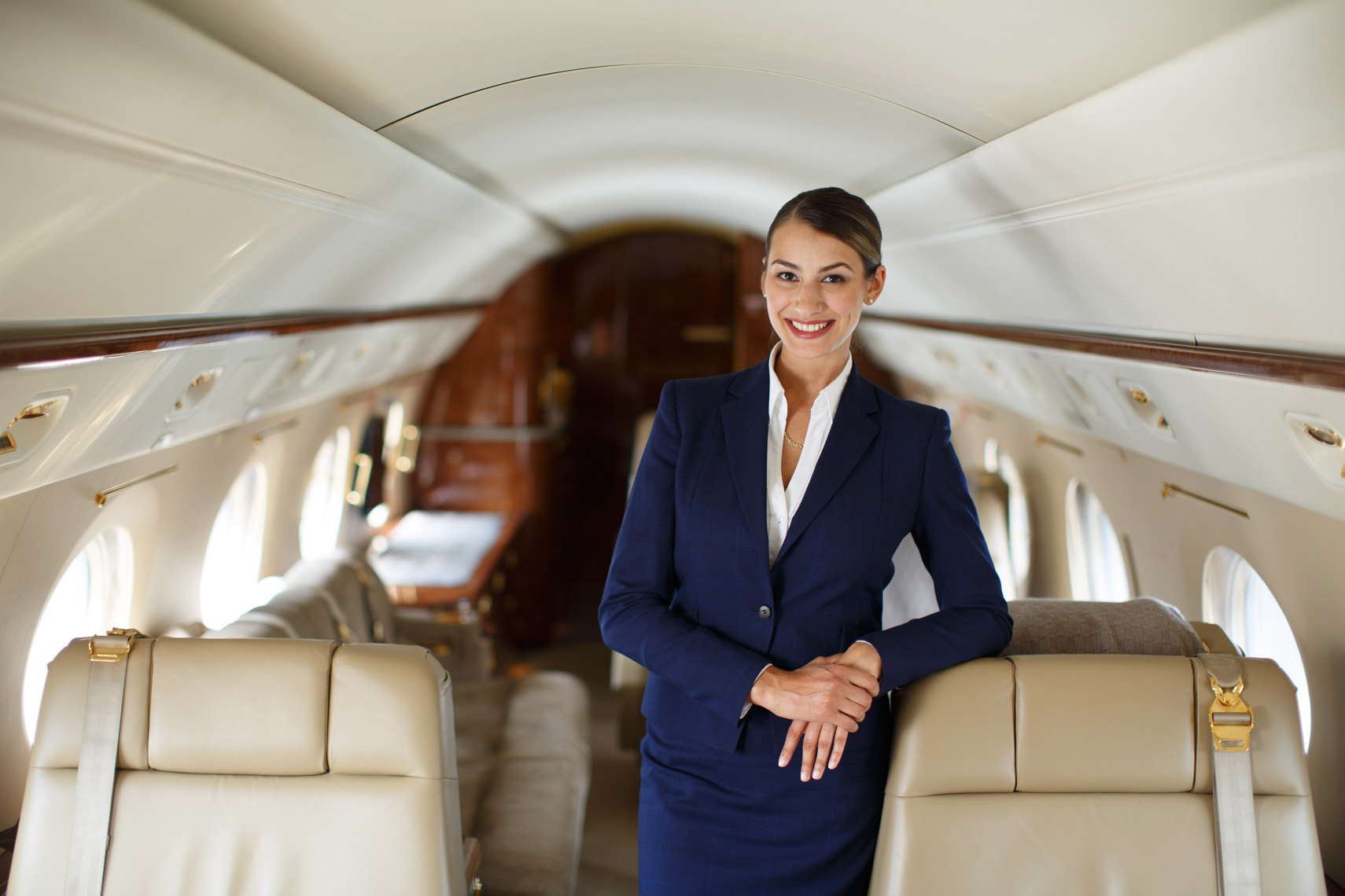 Jet Aviation - flight attendant portrait inside aircraft
