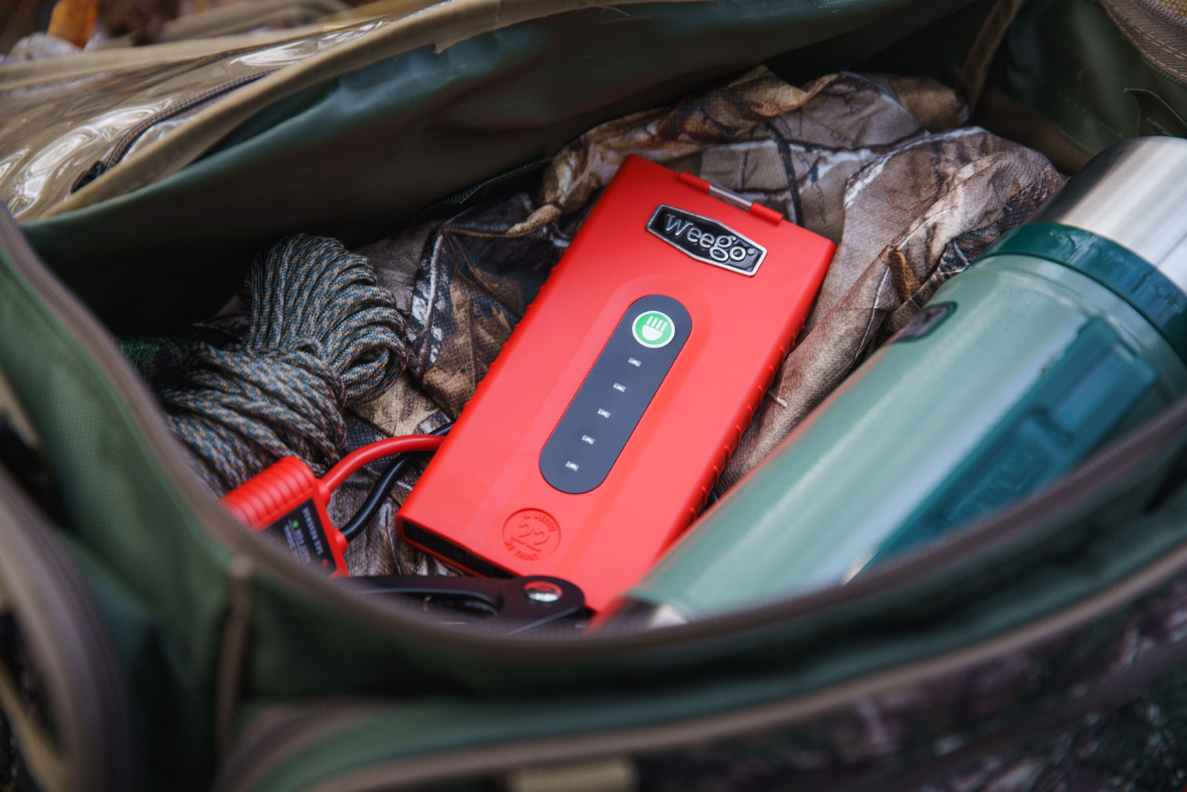 Portable battery among hunter gear