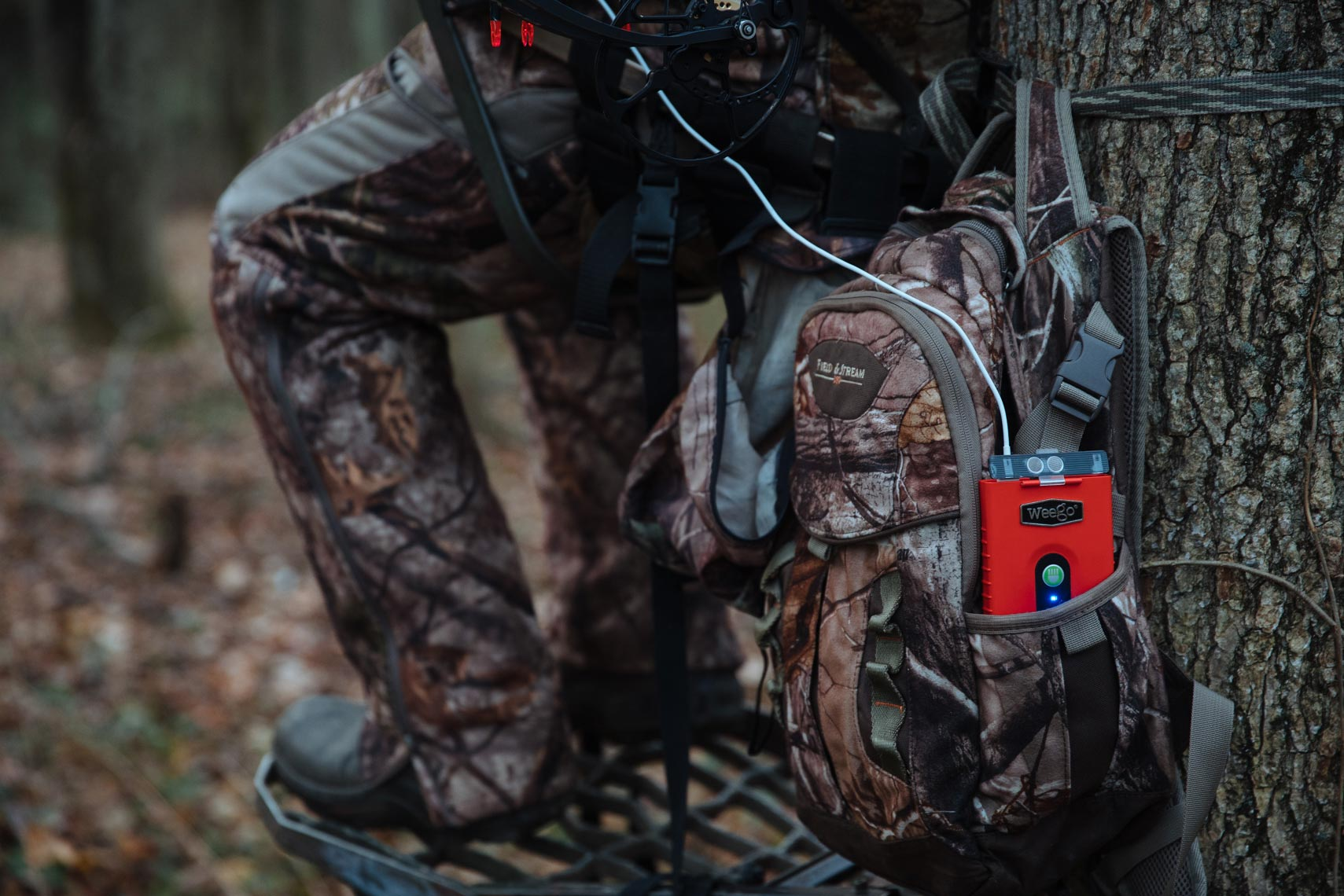 Portable battery in use by a hunter